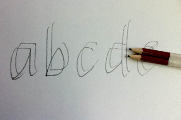 Drawing a typeface using two pencils
