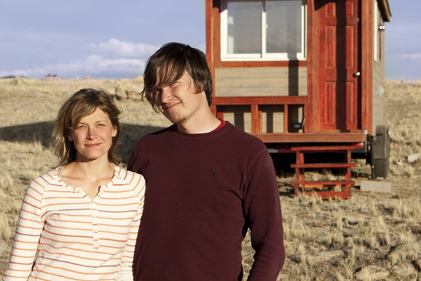 merete and christopher in front of their tiny home