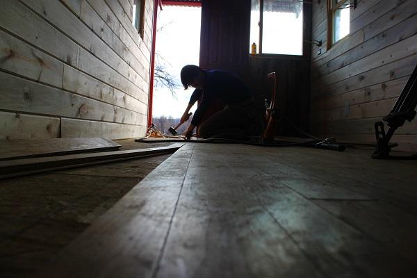 hammering down the flooring
