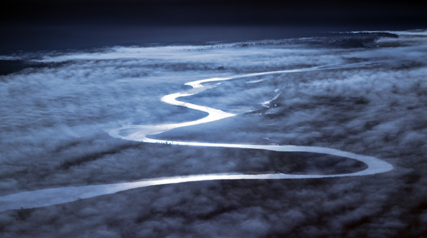 image of river through clouds in new zealand