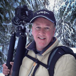 image of south island photographer mike hollman holding camera