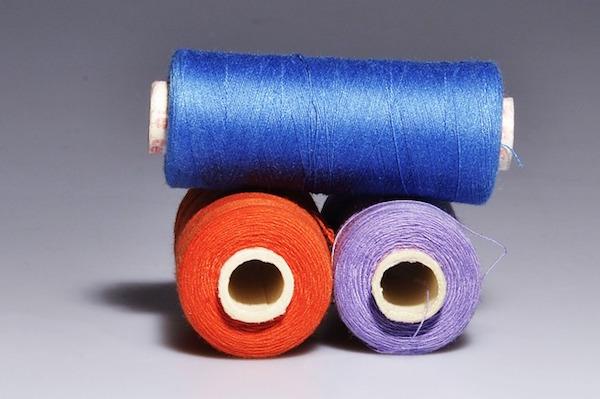 still life photograph of rolls of thread